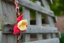 The garden outside the library mixed yarn flowers in with the real ones.