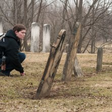 Paisley inspected the tomb stones and tried to piece together various family legacies.