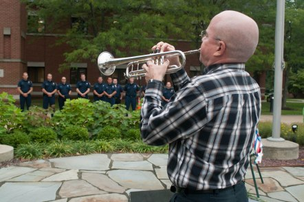 Dan Page played both 'Taps' and 'God Bless America' in the Memorial Garden in front of Stow City Hall. While Page has never served, his son is part of army special forces and will soon be leaving for Iraq.
